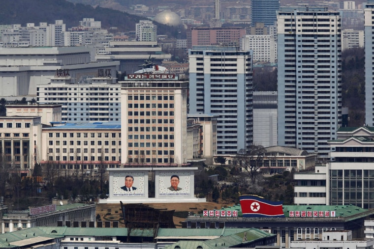 Image: File photo shows the current mosaic portrait of the founder of North Korea Kim Il-sung and the new portrait of late leader Kim Jong-il being seen in downtown Pyongyang