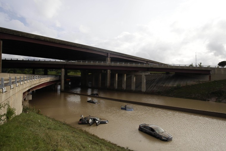 Image: Vehicles sit submerged in water along I-75 on Aug. 12 in Royal Oak, Mich