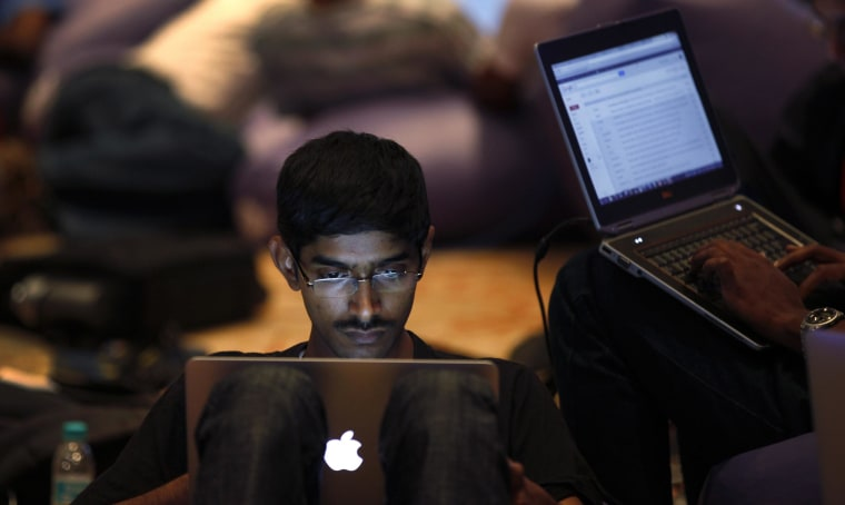 Image: A participant works on his laptop during the fifth edition of Open Hack in India in Bangalore, India,