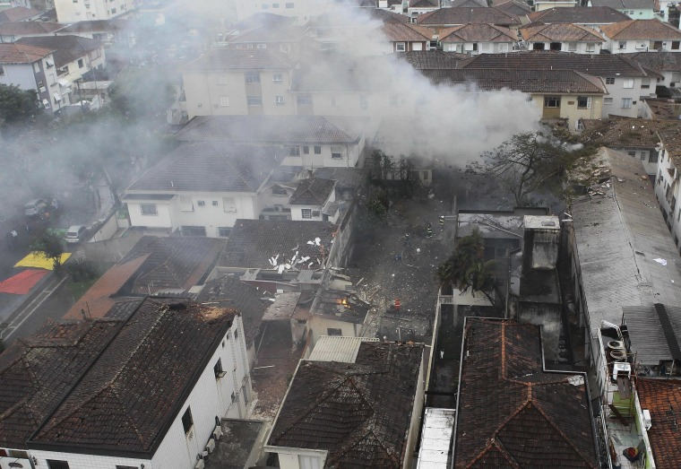 An aerial view where a private jet carrying Brazilian presidential candidate Eduardo Campos, who was running third in polls ahead of Brazil's October presidential election, crashed in Santos August 13, 2014. The plane, a Cessna 560XL, lost contact with air traffic control as it was preparing to land, according to an Air Force statement. The accident killed all seven people on board, the Sao Paulo state fire department said.