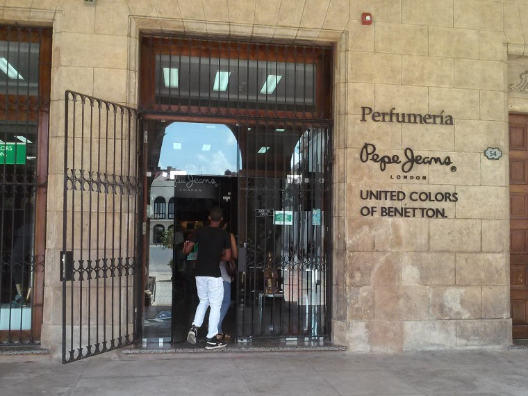 In Havana's Plaza Vieja, a Benetton store is a sign of tourist-friendly modernity.
