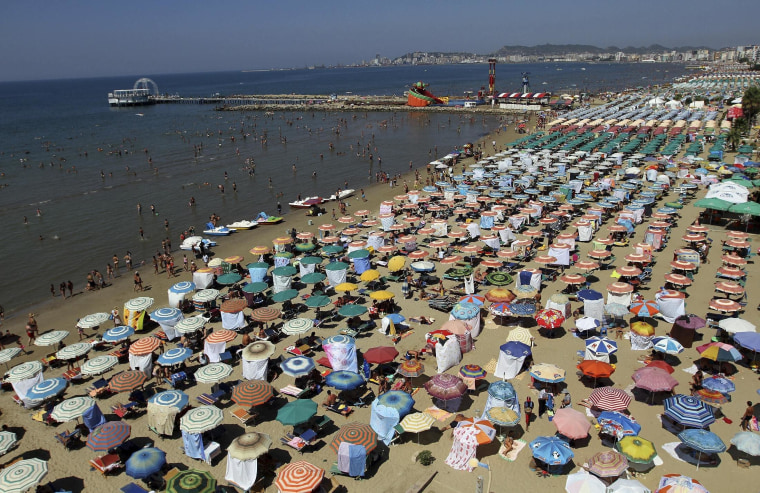 Image: A crowded beach in the city of Durres, Albania on Aug.13, 2014.