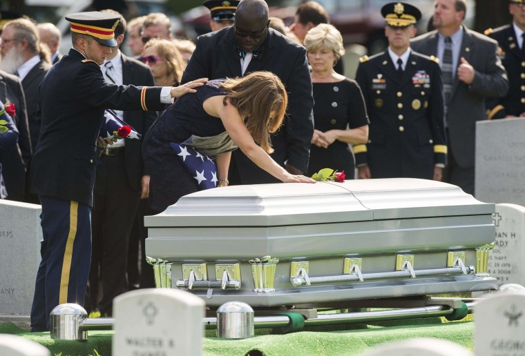 Image: Susan Myers places a flower on the casket of her husband, US Army Major General Harold Greene