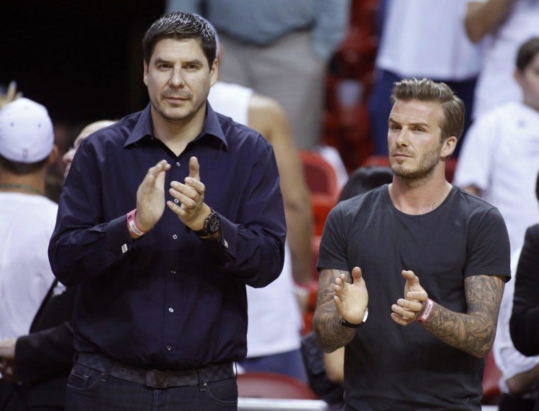 Image: File photo of former soccer player Beckham and founder of Brightstar Corp. Claure applauding before Game 5 of the NBA Eastern Conference final basketball playoff between the Indiana Pacers and the Miami Heat in Miami, Florida
