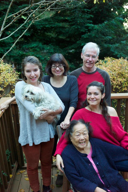 Susan Ito, husband John Roark, daughters Emma and Mollie, and Kiku at their home in Oakland.