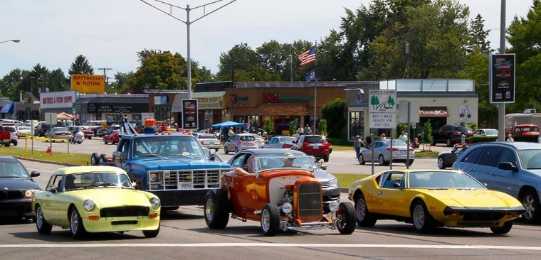 An old British sports car, a hot rod and a European exotic all wait for the light to go green as part of the build-up to the 20th annual Woodward Dream Cruise.
