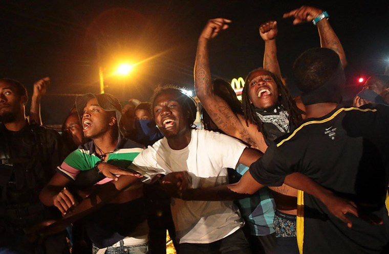 Image: Protestors defy police, take to the streets of Ferguson