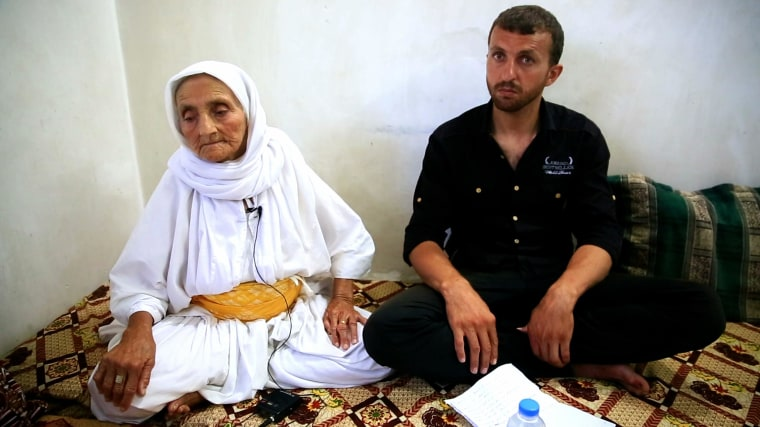 Assad Haig and his grandmother Aissan. The 84-year-old crawled for two days to reach safety after ISIS fighters overran the northern Iraqi town of Sinjar.