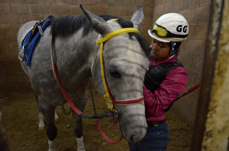 In This July 15 2014 Elizabeth Garrido 27 Prepares To Take A Horse The Track For Its Morning Workout At Hippodrome Of Americas Mexico City