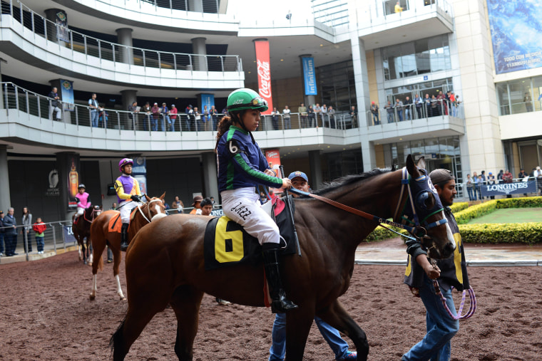 In This July 4 2014 Photo Jazmin Larios 22 Gets Ready To Compete A Race At The Hippodrome Of Americas Mexico City Like Most Jockeys