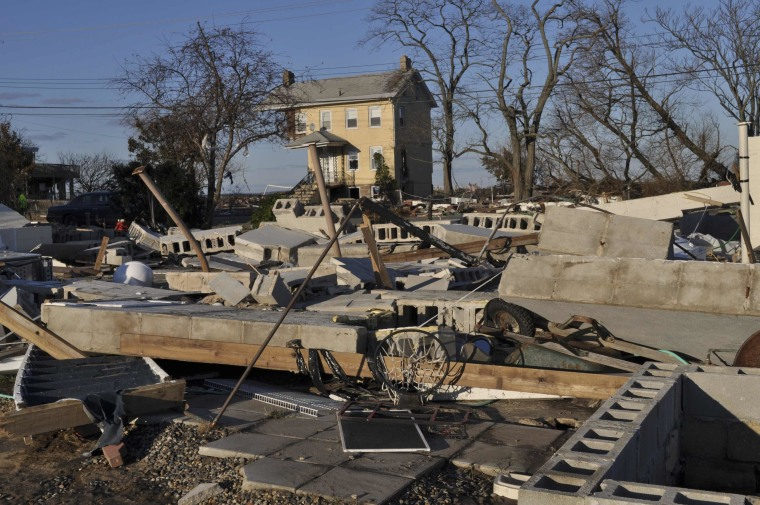 Image: Destruction in the aftermath of Hurricane Sandy is seen with this home that was ripped off its foundation and deposited, whole, in a nearby marshy area in Union Beach