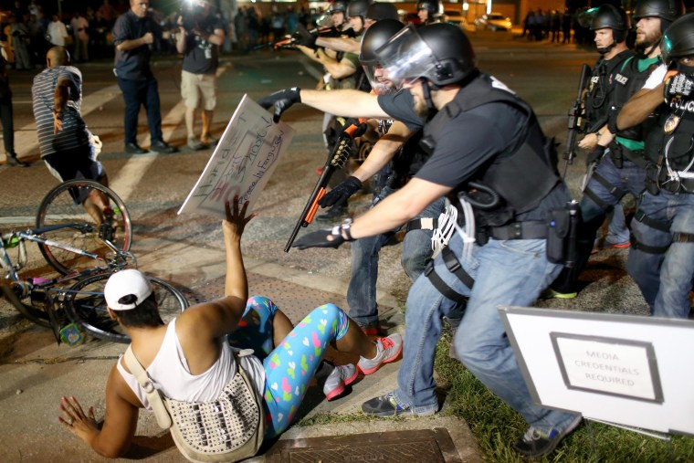 Police officers arrest a demonstrator on August 18, 2014 in Ferguson, Missouri. Violent outbreaks have taken place in Ferguson since the shooting death of unarmed teenager Michael Brown by a Ferguson police officer on August 9th.