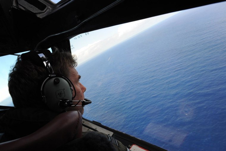 Royal New Zealand Air Force (RNZAF) P-3K2-Orion aircraft co-pilot and Squadron Leader Brett McKenzie helping to look for objects during the search for missing Malaysia Airlines flight MH370, far off the coast of Perth on April 13, 2014.