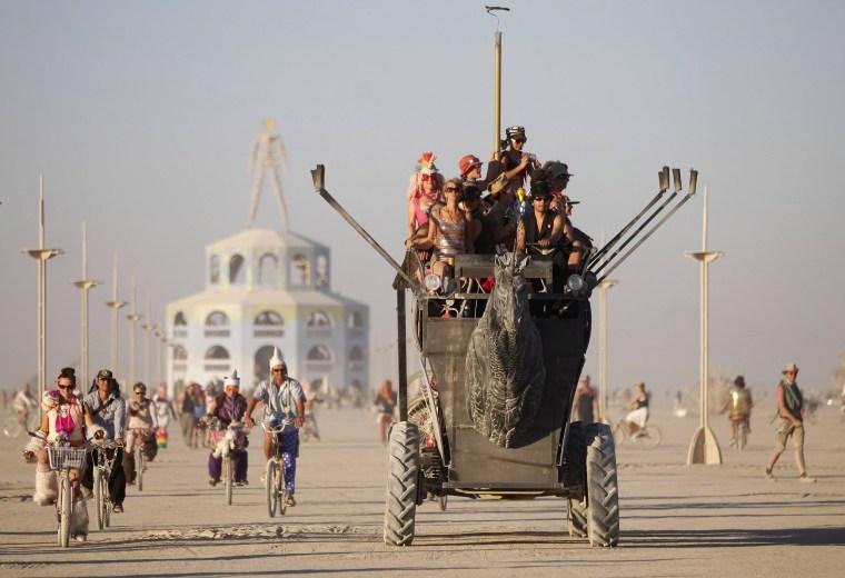 Image: Participants ride an art car during the Burning Man 2012