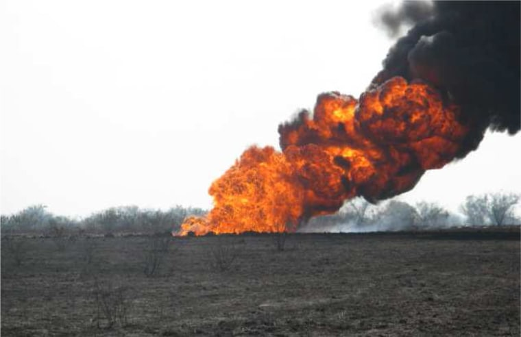 A fireball burns in the distance in June 2010, hours after a gathering pipeline ruptured near Alice, Texas, in 2012.