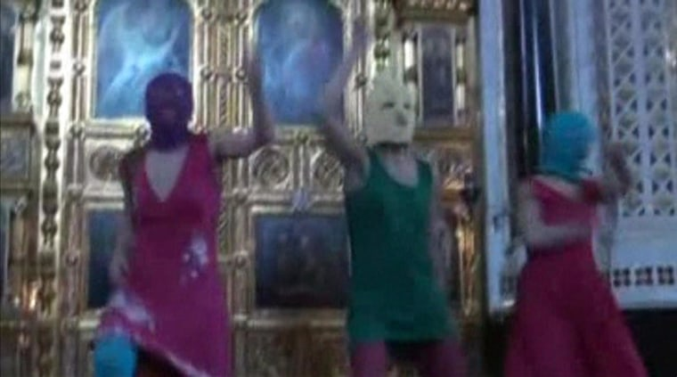 "Image: Still image taken from file video shows members of the female punk band ""Pussy Riot"" staging a protest inside Christ The Saviour Cathedral in Moscow"