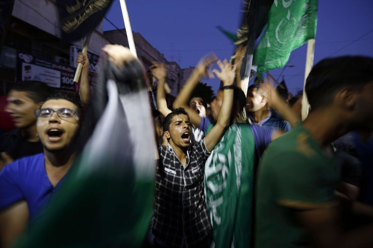 Image: Palestinians gather in the streets of Gaza City on Aug. 26, to celebrate the long-term truce agreed between Israel and the Palestinians