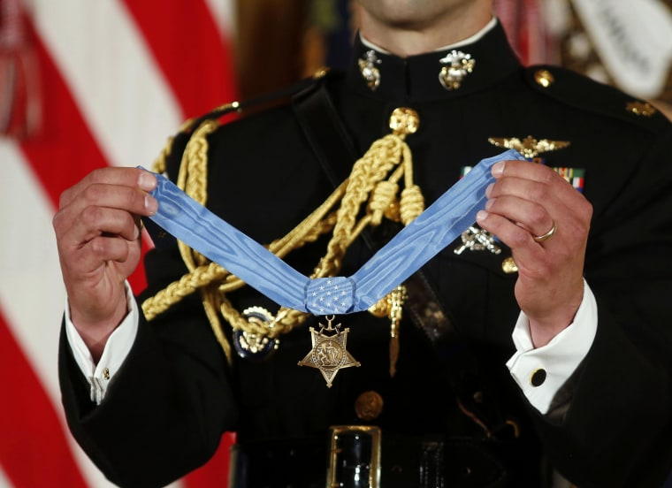 Image: The Medal of Honor is held up before Obama presents it to retired U.S. Marine Corps Corporal Carpenter during a ceremony at the White House in Washington