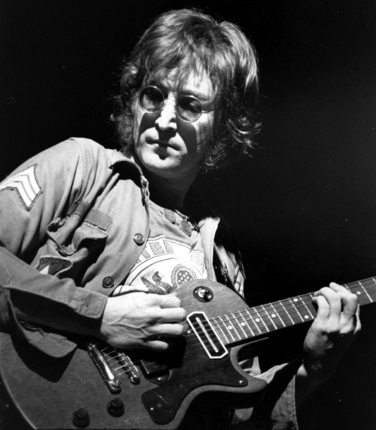 John Lennon\'s Stolen Guitar Fetches a Fortune at Auction