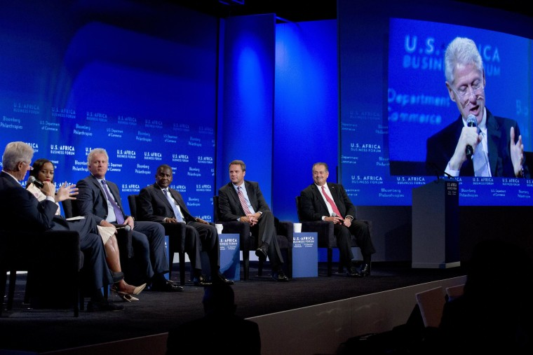 Image: Bill Clinton, Aliko Dangote, Jeff Immelt, Andrew Liveris, Phuti Mahanyele, Doug McMillon