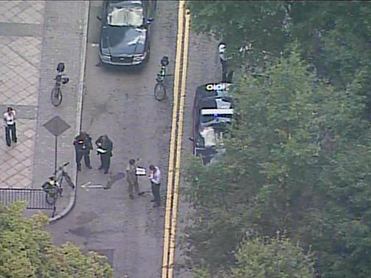 Image: Investigators on the scene at Woodruff Park in Atlanta where an officer shot a man with a knife.