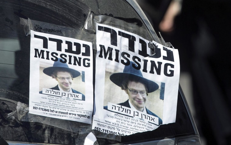 Flyers asking for help in the search for missing New Jersey native Aaron Sofer, 23, are taped to a car window near the Jerusalem Forest, where a body was found Thursday.