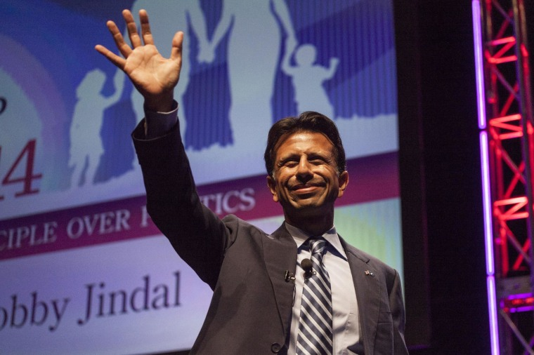 Image: Louisiana Governor Jindal waves as he speaks at the Family Leadership Summit in Ames