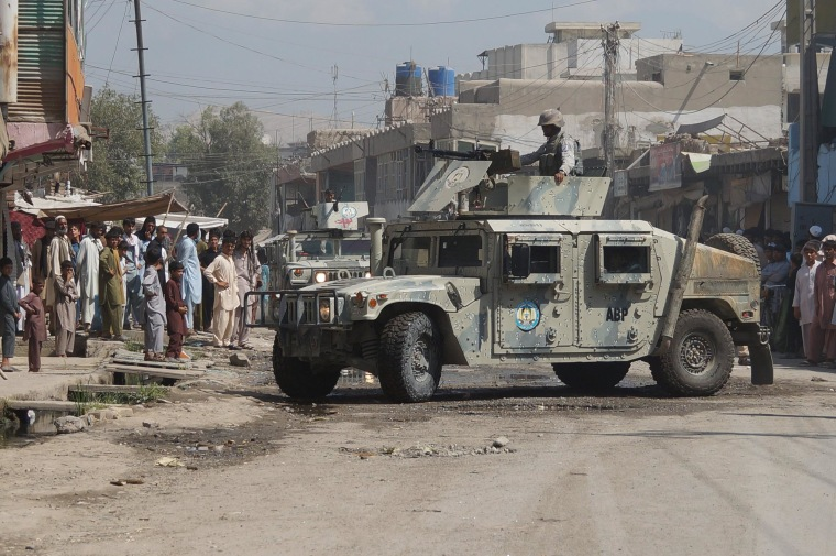 Afghan security forces inspect the site of a suicide attack in Jalalabad, east of Kabul, Afghanistan, Saturday.