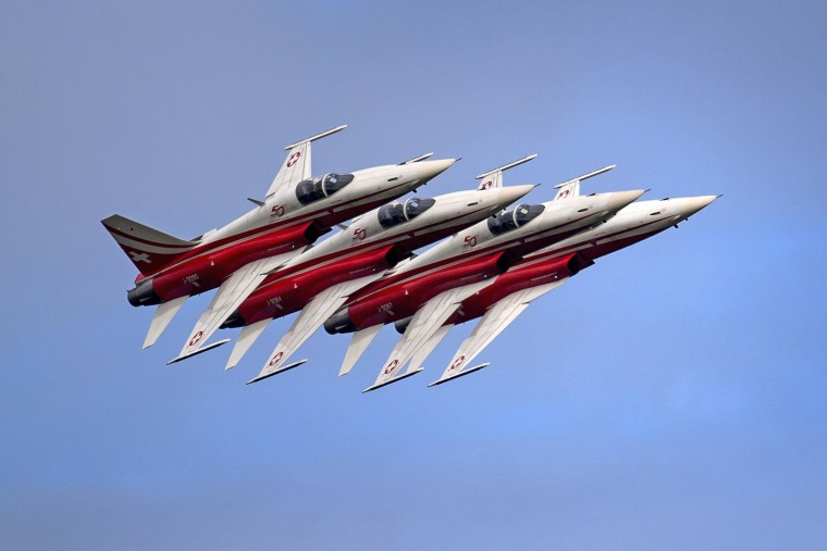 Fighter jets of the Swiss Patrol perform on Aug. 30, 2014 during the first day of AIR14 airshow in Payerne, western Switzerland.