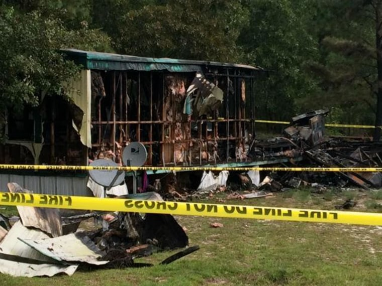 The wreckage of a mobile home that caught fire in Garland, N.C., Saturday, Aug. 8. Firefighters found the bodies of six people that apparently died in the blaze.