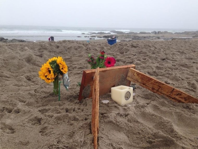 A memorial on a Lincoln City, Oregon, beach for 9-year-old Isabel Grace Franks, who died in a sand collapse Friday.