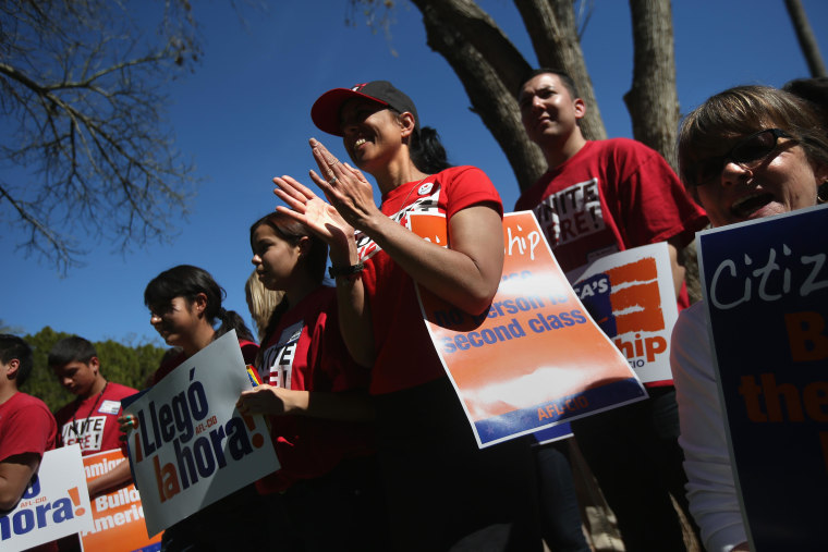 File photo of Arizona union supporters gathering in support of national immigration reform outside the Arizona State Capitol building on March 11, 2013 in Phoenix, Arizona. The rally, organized by the AFL-CIO, was part of a national tour in support of immigration reform which protects workers' rights.
