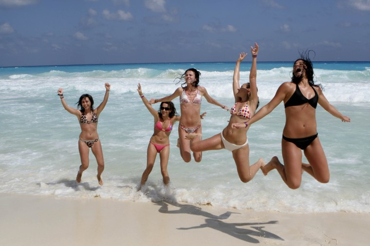 File photo of students on the beach in Cancun, Mexico. Mexico experienced a record summer for tourism this year. (AP Photo/Israel Leal)