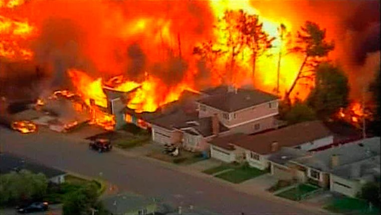Image: A massive fire caused by a gas pipe explosion in San Bruno