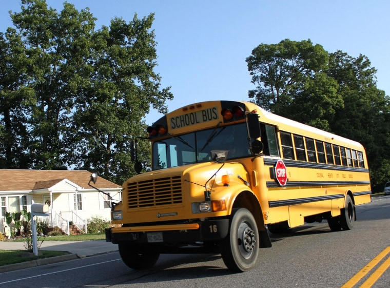 A school bus cruises down Conduit Road Tuesday, Sept. 2, 2014. Most students in the Tri-Cities returned to school on the traditional day after Labor Day, although some Petersburg students started in August.