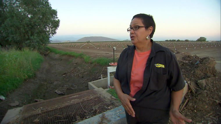 Image: Becky Quintana, resident of Seville, CA shows the old public water works infrastructure near her house.