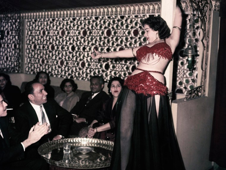 Image: A belly dancer performs at the Abdin Casino in Cairo, Egypt