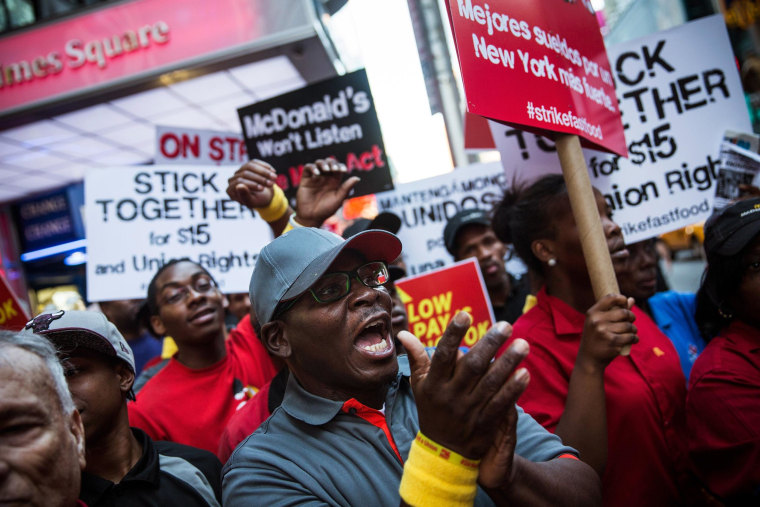 Image: Protesters demanding higher wages and unionization for fast food workers march near Times Square in New York City.