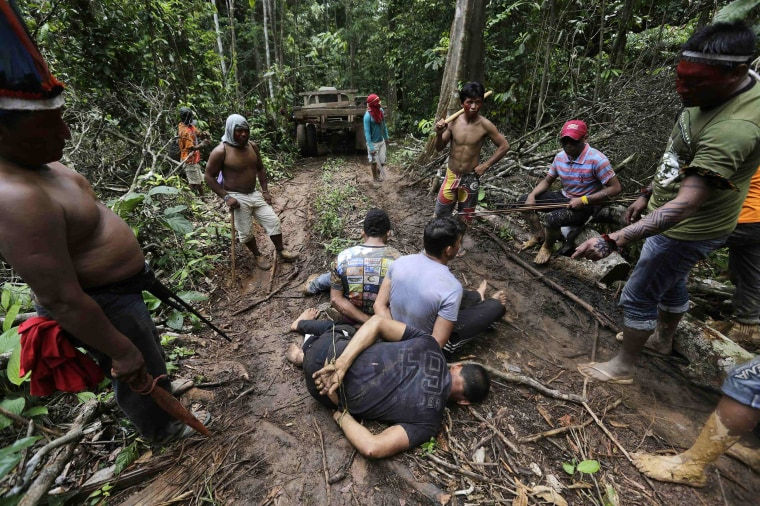 Ka'apor Indian warriors tie up loggers during a jungle expedition to search for and expel them from the Alto Turiacu Indian territory, near the Centro do Guilherme municipality in the northeast of Maranhao state in the Amazon basin, on Aug. 7.
