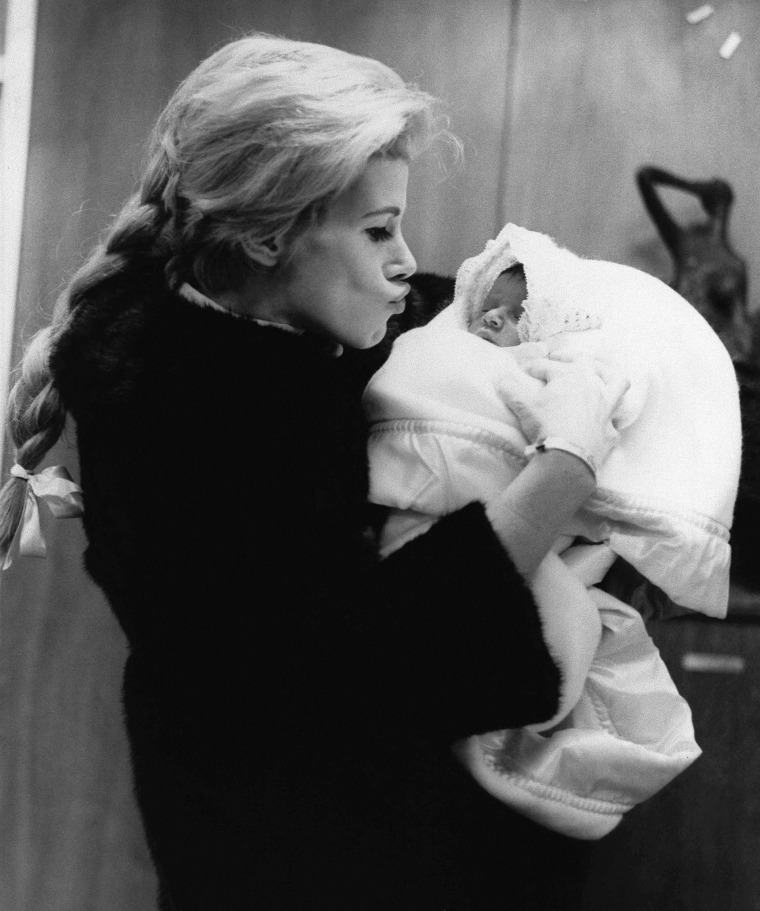 Comedienne Joan Rivers with daughter Melissa as they leave Lenox Hill Hospital, Jan. 1968, where the baby, Joan's first, was born on January 20. Father is TV producer Edgar Rosenberg. (AP Photo) No Sales