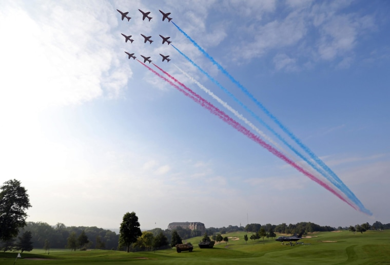 Aircraft from the British Royal Air Force's Red Arrows aerobatic team create colored vapor trails as they fly over the Celtic Manor resort, the venue for the NATO summit, in south Wales on Sept. 5, 2014.