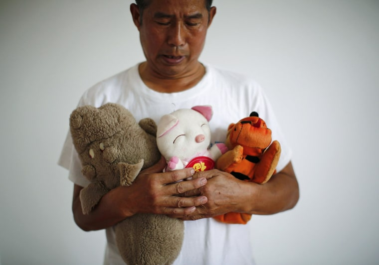 Image: Zhang Yongli, whose daughter Zhang Qi was onboard Malaysian Airlines Flight MH370 which disappeared on March 8, 2014 looks at his daughter's plush toys as he poses for a picture, during an interview with Reuters in Beijing