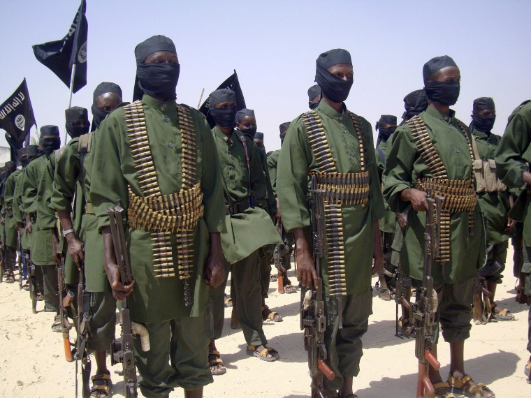 Al-Shabab fighters stand in formation with their weapons during military exercises on the outskirts of Mogadishu, Somalia on Feb. 17, 2011.