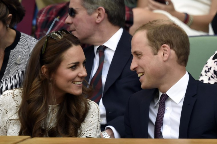 Prince William, the Duke of Cambridge, and his wife Catherine, the Duchess of Cambridge, sit in the Royal Box on Centre Court during the men's singles quarter-final match between Britain's Andy Murray and Bulgaria's Grigor Dimitrov on day nine of the 2014 Wimbledon Championships at The All England Tennis Club in Wimbledon, southwest London, on July 2, 2014.