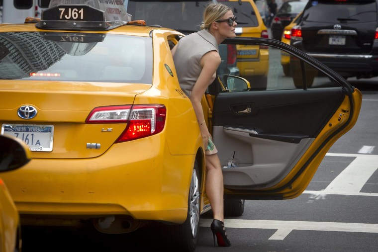 Image: A fashionista gets into a taxi outside the Lincoln Center during New York Fashion Week in the Manhattan borough of New York