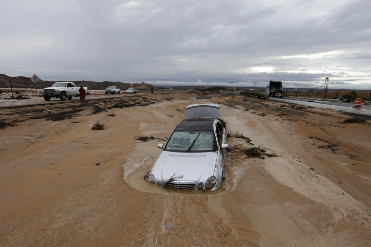 Image: A car is partially buried in mud