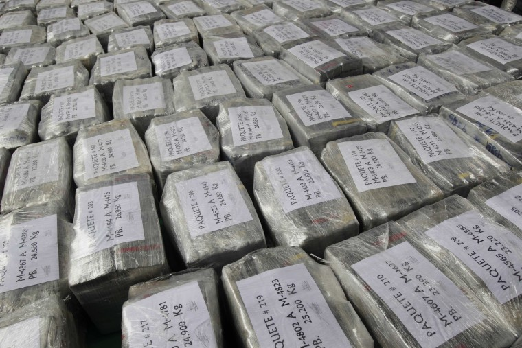 Packages containing seized cocaine are put on display after their arrival at the police airport in Lima September 1, 2014. Peruvian police seized a record 7.6 tons of cocaine in a quiet coastal town last week, arresting seven Peruvians and two Mexicans suspected of trying to smuggle the load to Europe as coal, according to Peru's Interior Ministry.