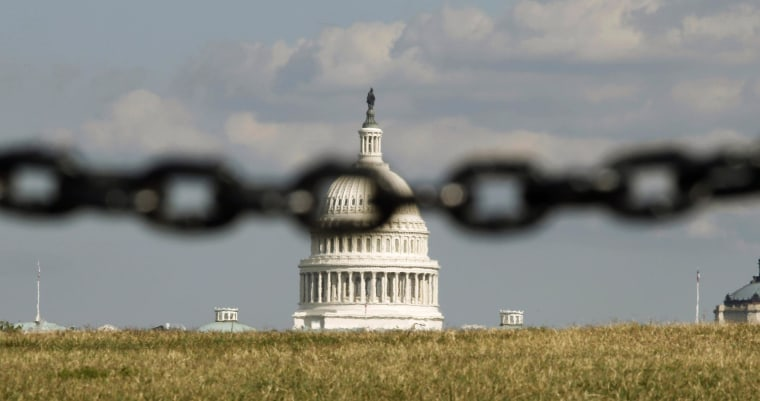 Image: File photo of the U.S. Capitol pictured behind a chain link fence in Washington