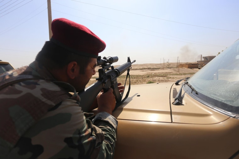 Image:  A Peshmerga targeting a point by a M16 in Al-Bakir neighborhood of Mosul, Iraq