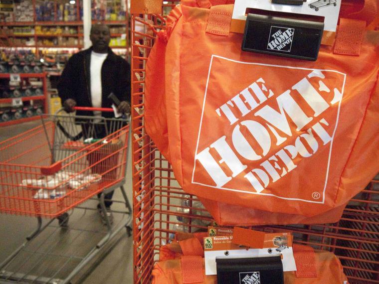 Image: A customer wheels a cart through a Home Depot store in Washington